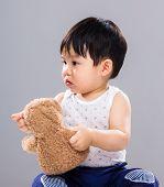 stock photo of baby bear  - Baby boy play with toy bear - JPG