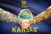 picture of kansas  - Soldiers handshake and US state flag  - JPG