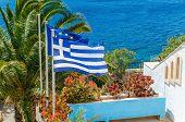 image of greek-island  - Greece and European Union flag on the background of plam tree and sea taken on Greek Island - JPG