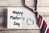 image of backround  - Happy fathers day sign on paper and colorful tie laid on wooden floor backround - JPG