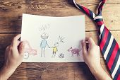 image of backround  - Fathers day composition with childs drawing and colorful tie laid on wooden desk backround - JPG