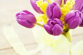foto of mimosa  - Bouquet of purple tulips and mimosa in vase on wooden background toned - JPG
