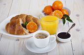 pic of croissant  - Healthy breakfast with fresh croissants coffee jam juice and tangerines in a plate on a wooden background - JPG