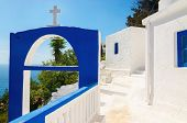 image of greek  - A view of a Greek church with iconic blue colors and see in the background on Greek island - JPG