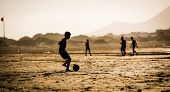 foto of beach-ball  - Silhouette of  the boy on the beach with a ball - JPG