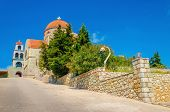 stock photo of greek  - View on Greek typical church with classic red roofing - JPG