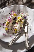foto of edible  - Presentation of goat cheese rolls with edible flowers - JPG