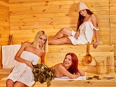 stock photo of sauna  - Group women sitting on bench in sauna - JPG