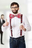 image of suspenders  - Funny man wearing suspenders with ok sign and glass of milk - JPG