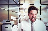 stock photo of yell  - Businessman stressed and overworked yelling in office - JPG