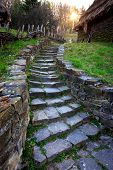 picture of old stone fence  - old stone footsteps on sunset background