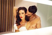 picture of lovers  - Sensual woman with young macho lover in mirror - JPG