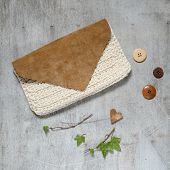 picture of clutch  - Fashion Leather Bags on grunge concrete background clutch handmade wooden background with buttons - JPG