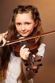 picture of hair bow  - Cheerful girl with long hair holding the fiddle - JPG