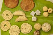stock photo of pooja  - Top View of Traditional Ceremonial Indian Sweets and Snacks from India - JPG