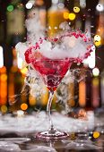 picture of vapor  - Cocktail with ice vapor and splashing liquid on bar desk - JPG