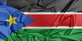 foto of waving  - Flag of South Sudan waving in the wind - JPG