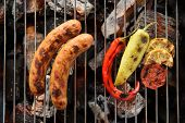 picture of grilled sausage  - sausages and grilled vegetables on the grill close up - JPG