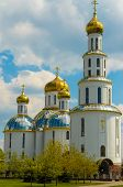 stock photo of cupola  - Church with golden cupolas in the city of Brest in early spring - JPG