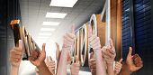 foto of binary code  - Hands showing thumbs up against 3d binary code in data center hallway - JPG