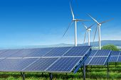 stock photo of turbines  - solar panels and wind turbines under blue sky on summer landscape - JPG