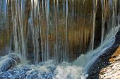 stock photo of damme  - closeup of water falling over a damm in new england - JPG