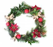stock photo of christmas wreaths  - a christmas wreath wreath isolated on a white background with a gold bow and red flowers - JPG