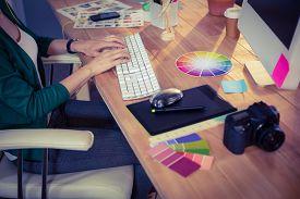 stock photo of creativity  - Designer working at her desk in creative office - JPG