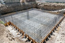 stock photo of foundation  - Foundation of a new house with reinforced concrete - JPG