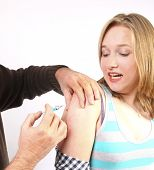 Young Woman Getting A Vaccine