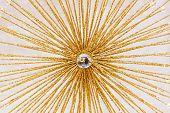 foto of gold glitter  - Abstract art decoration in shape of sun rays - JPG