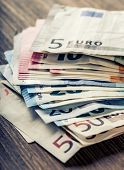 Постер, плакат: Several hundred euro banknotes stacked by value Euro money concept Euro banknotes Euro currency