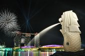 Singapore skyline and river shining with fireworks