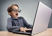 Shocked and surprised boy on the internet with laptop computer concept for amazement, astonishment,  poster