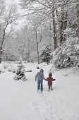 boy and girl walking through the snow