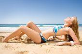 Beautiful Red Head Bikini Model Lying On Beach