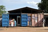 JUBA â?? JUNE 10: Unidentified men standing in front of containers turned into a shop in Juba, capit
