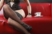 Woman Wearing Sexy Lingerie Having Coffee Cup poster