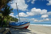 View of rustic boat at the beach in Mancora Beach Peru poster