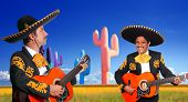 Mexican two mariachis with charro costume singing playing guitar in cactus Mexico
