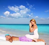 blond woman therapist in Caribbean beach doing meditation shiatsu massage in paradise