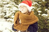 Small Naughty Santa Boy In Winter Outdoor poster
