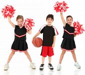Group Of Children Cheerleaders And Basketball Player