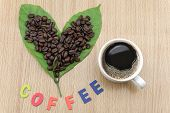 Coffee Cup With Coffee Beans And Coffee Leaves poster