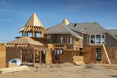 stock photo of rafters  - Home addition under construction with plywood structure half finished - JPG