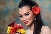 Young asian woman with flowers tender fashion portrait poster