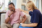 Support Worker Visits Senior Man Suffering With Depression poster