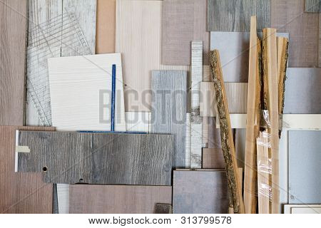 poster of Wooden Pillars And Thick Boards In The Furniture Workshop Are Ready To Work Joiner, Selective Focus
