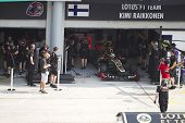 Kimi Raikonnen gets ready to leave his pit garage