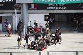 Romain Grosjean pushed back to his pit garage